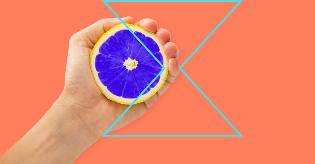 person squeezing a lemon