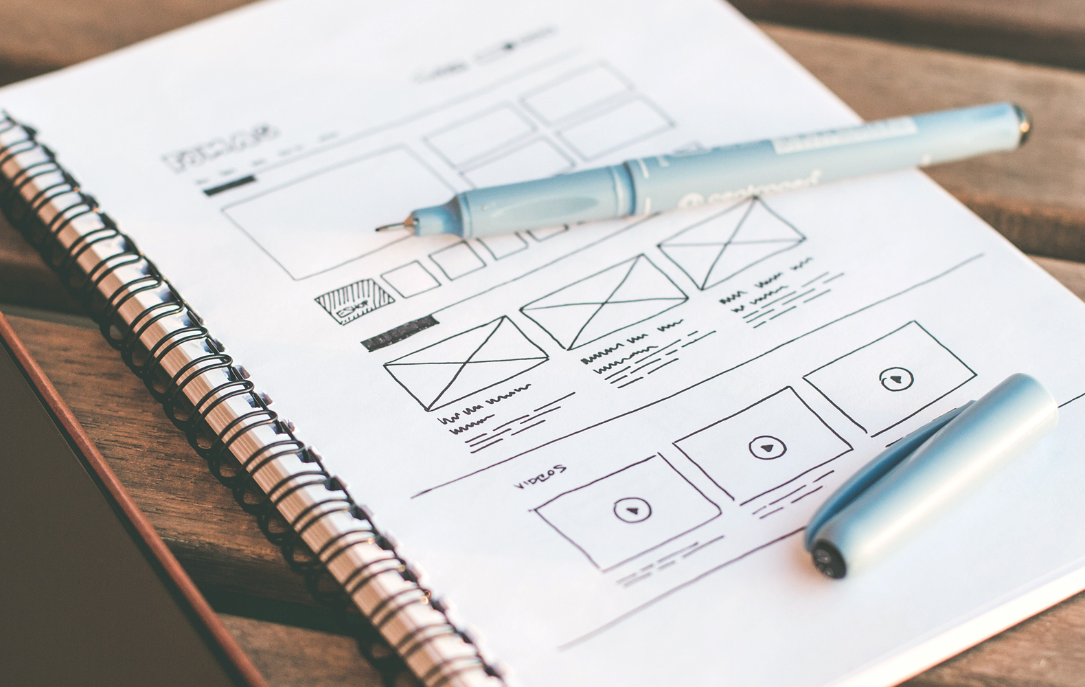 hand-sketched wireframe in notebook